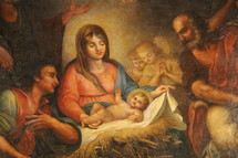 Traditional painting of Mary and baby Jesus in the manger surrounded by shepherds and wise men.