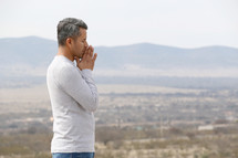 a man with praying hands