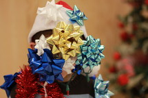 Child covered with Christmas decorations.