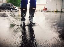 splashing in a puddle wearing galoshes