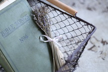 Bible songs book and lavender in a wire basket