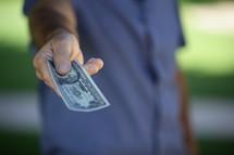 man handing money