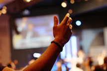a raised hand at a worship service