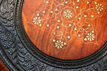 Oriental brass inlaid carved wooden table top