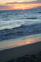 waves crashing onto a beach