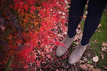 boots standing near red leaves