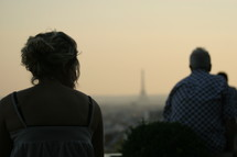 tourists looking out at the Eiffel Tower in the distance