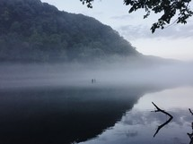 fog and mist over a lake