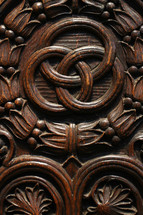 detail carved into a wood door