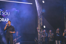 man singing at a concert
