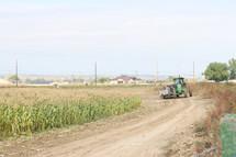 a tractor in a corn field