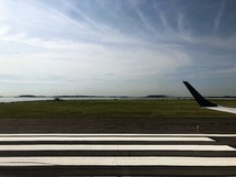 wing of a plane on a runway