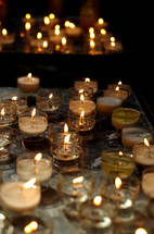 flames on votive candles