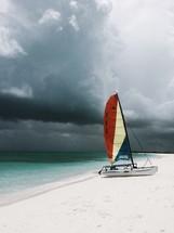 catamaran on a beach and a stormy sky