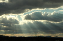 rays of sunlight shining through the clouds