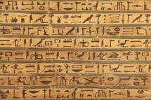 Egyptian hieroglyphics painted onto a stone tablet
