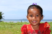 Smiling face of a young Micronesian girl