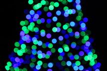 green and blue bokeh lights on a Christmas tree
