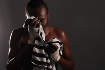 boxer wiping sweat from his brow