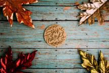 give thanks on teal wood boards and metallic fall leaves