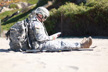 soldier sitting reading