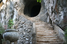 stairs leading up to a tunnel