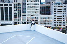 person sitting on the roof of a building