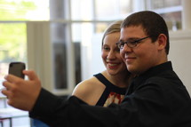 Teen couple taking a selfie.