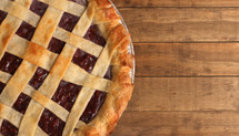cherry pie on a wood counter