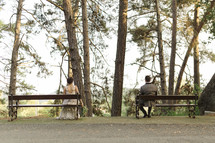 bride and groom sitting on benches