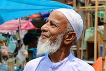 Elderly Muslim man with skull cap and grey beard [For similar, try search Ethnic Face]