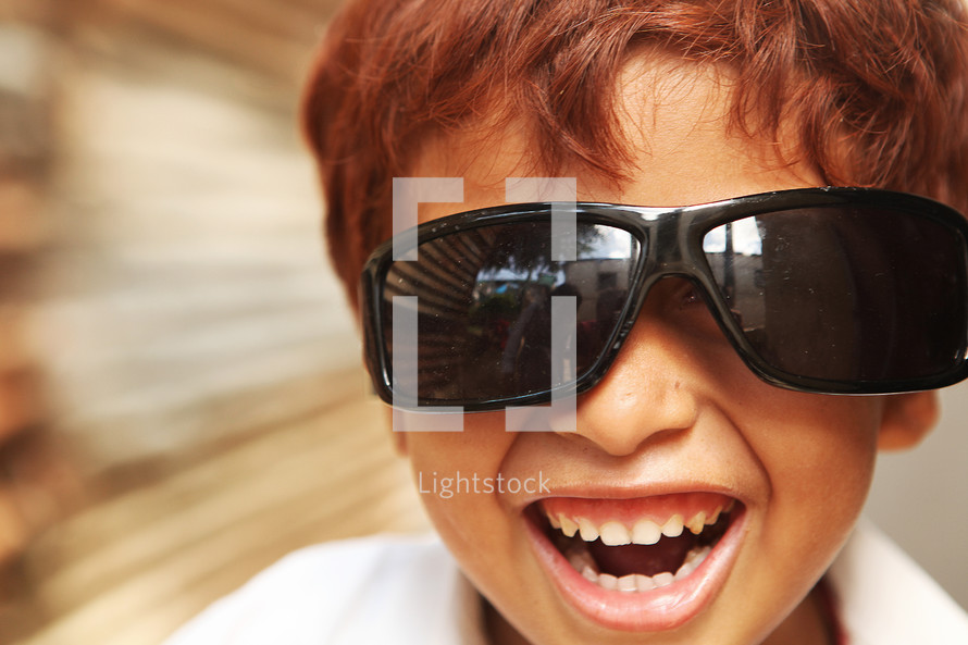 Young boy wearing sunglasses