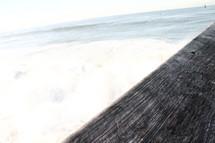 part of a wood pier over ocean