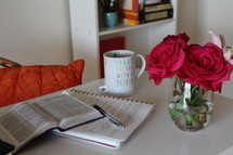 roses in a vase and notebook and Bible