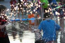 boys playing in a splash park
