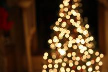Christmas tree glowing with lights.