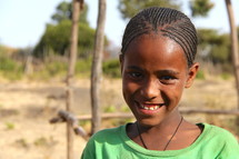 Smiling young girl in Africa