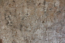 Chinese words carved into an ancient tower wall