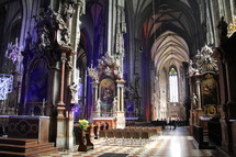 Inside of an elaborate cathedral.