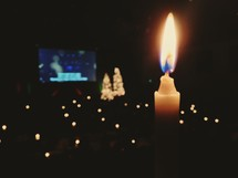 Candles burning at a Christmas Eve Service.