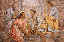 tile mosaic of Jesus washing feet
