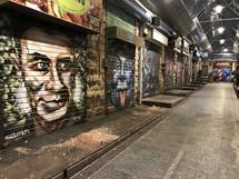 street art of faces on garage doors