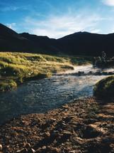 people walking in a stream