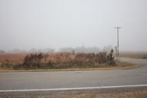 a rural road in fog