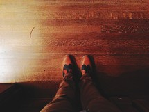 looking down at a man's dress shoes