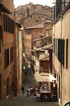 narrow alley between buildings in an Italian city