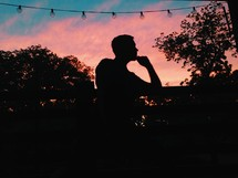 silhouette of a man thinking