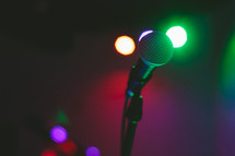 Microphone on a lighted stage.