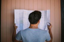 a man reading a map