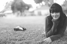 smiling teen laying in the grass